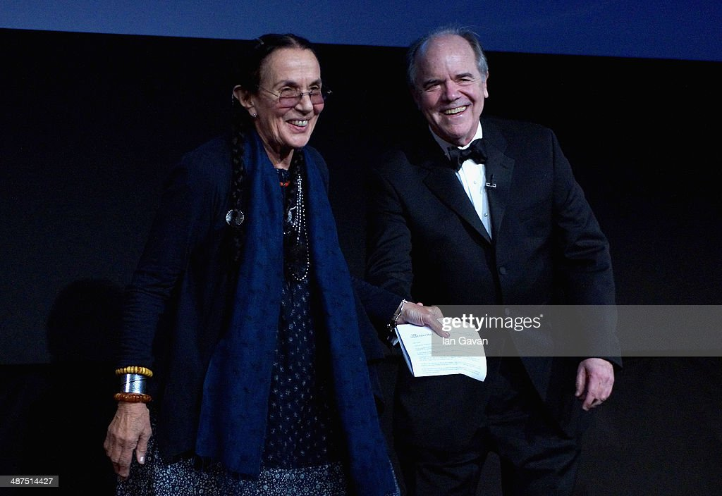 Mary Ellen Mark, winner of the Outstanding Contribtuion to Photography award and host Bill Hunt on stage at the 2014 Sony World Photography awards (SWPA) at the London Hilton on April 30, 2014 in London, England.