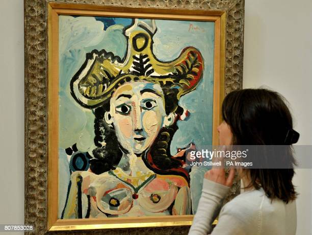 Mary Engelhart studies Picasso's Femme au Grand Chapeau Buste which is estimated value of $8/12 million at the Sotheby's showroom in New Bond Street...
