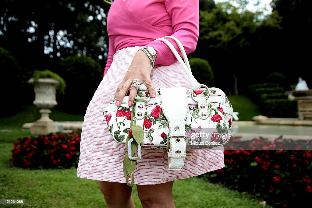 Mary Ferraj Volo seen wearing an Anko plus Dolce & Gabbana's dress, a Dolce & Gabbana's handbag, Sergio Rossi's shoes and Reminiscene, Cartier and Salvini jewelry during the 'Festival Jardins de Pedralbes' on June 25, 2014 in Barcelona, Spain.