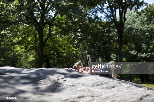 Mary Fink visiting from Port St Lucie Florida reads a book in Central Park during a heat wave on July 12 2011 in New York City The National Weather...