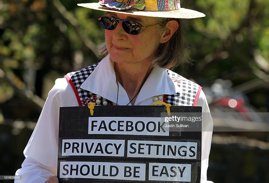 Mary Guedon of the group Raging Grannies holds a sign as she protests outside of the Facebook headquarters June 4, 2010 in Palo Alto, California. The group was calling for the FTC to investigate FaceBook's privacy policies.