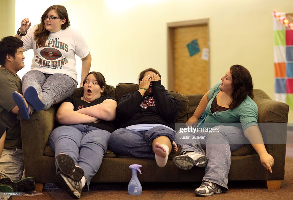 Mary Healy, Makayla Smith, Marissa Hamilton and Elizabeth Fedorchalk react as a classmate surprises them as they sit in the girls dorm at Wellspring Academy October 21, 2009 in Reedley, California. Struggling with her weight, seventeen year-old Marissa Hamilton enrolled at the Wellspring Academy, a special school that helps teens and college level students lose weight along with academic courses. When Marissa first started her semester at Wellspring she weighed in at 340 pounds and has since dropped over 40 pounds of weight in the first two months of the program. According to the Centers for Disease Control and Prevention, 16 percent of children in the US ages 6-19 years are overweight or obese, three times the amount since 1980.