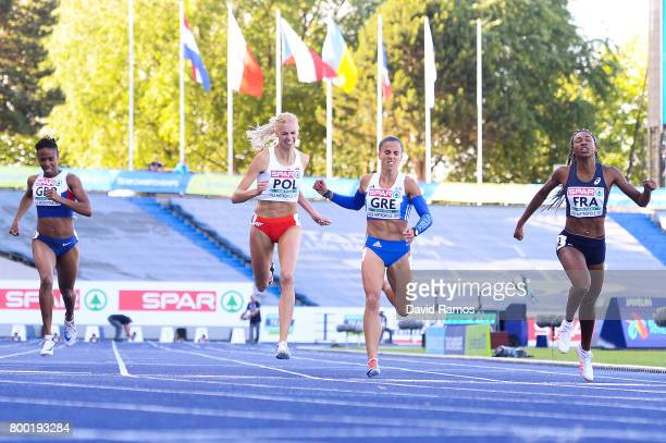 Mary Iheke of Great Britain Iga Baumgart of Poland Irini Vasiliou of Greece and Deborah Sananes of France compete in the Women's 400m heat 2 during...