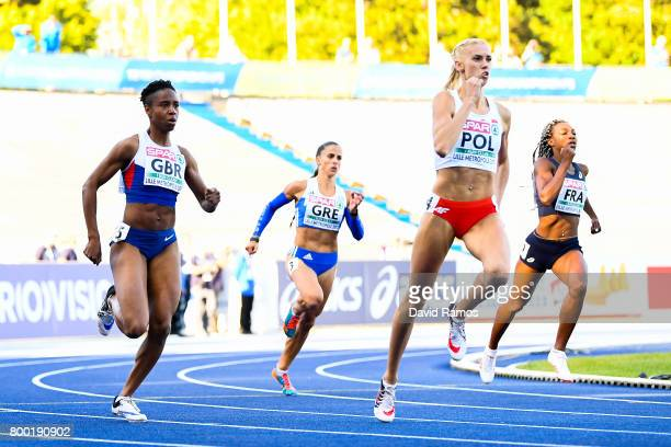 Mary Iheke of Great Britain Irini Vasiliou of Greece Iga Baumgart of Poland and Deborah Sananes of France compete in the Women's 400m heat 2 during...