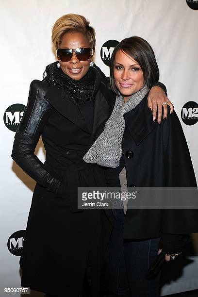 Mary J Blige and Angie Martinez attend Mary J Blige's album release party at M2 Ultra Lounge on December 22 2009 in New York City