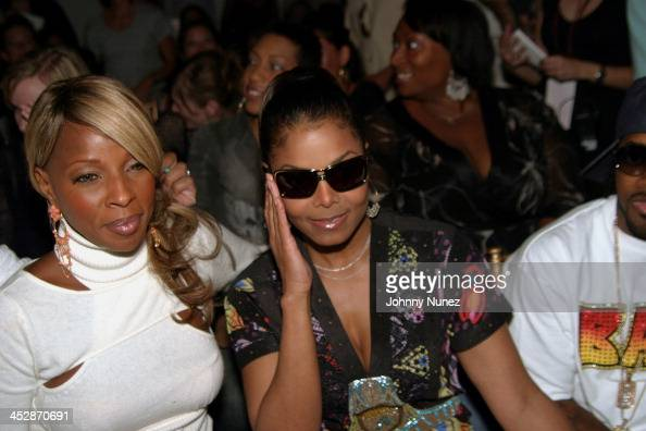 Mary J Blige and Janet Jackson during Olympus Fashion Week Spring 2005 Baby Phat Front Row at Skylight Studio in New York City New York United States