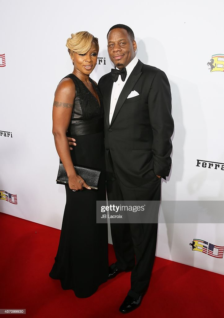 Mary J. Blige and Kendu Isaacs attend Ferrari's 60th Anniversary in the USA Gala at the Wallis Annenberg Center for the Performing Arts on October 11, 2014 in Beverly Hills, California.