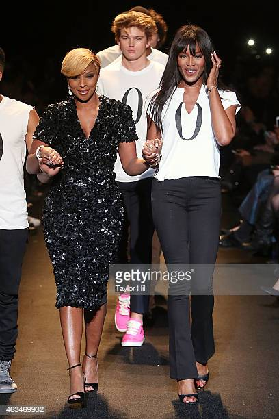 Mary J Blige and Naomi Campbell walk the runway during Naomi Campbell's Fashion For Relief 2015 fall fashion show at The Theater at Lincoln Center on...