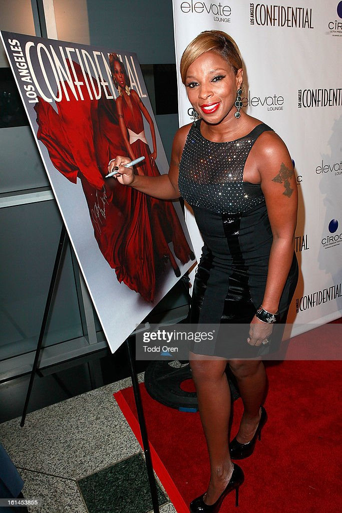 <a gi-track='captionPersonalityLinkClicked' href=/galleries/search?phrase=Mary+J.+Blige&family=editorial&specificpeople=171124 ng-click='$event.stopPropagation()'>Mary J. Blige</a> poses at the Los Angeles Confidential Celebrate THE GRAMMYS at Elevate Lounge on February 10, 2013 in Los Angeles, California.