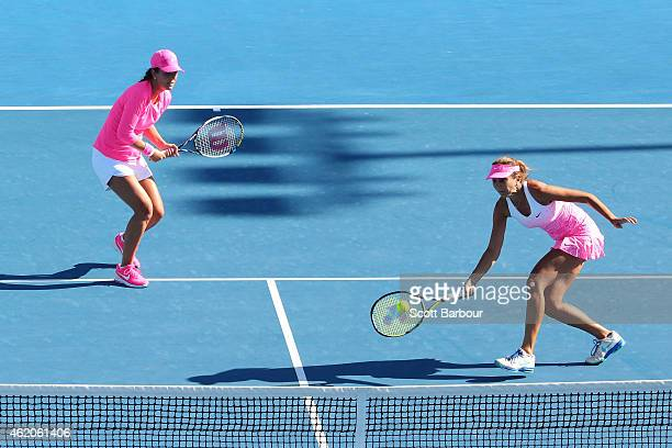 Mary Joe Fernandez of the United States and Iva Majoli of Croatia in action in their second round doubles match against Nina Bratchikova of Russia...