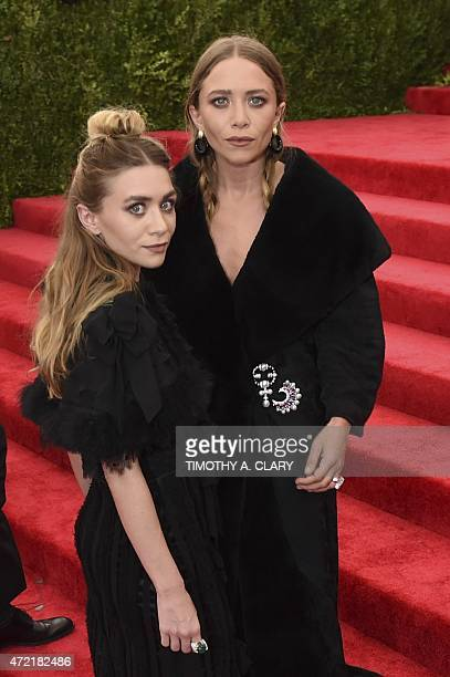 Mary Kate and Ashley Olsen arrive at the Costume Institute Gala Benefit at The Metropolitan Museum of Art May 5 2015 in New York AFP PHOTO / TIMOTHY...