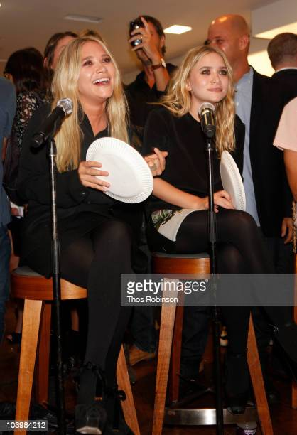 Mary Kate Olsen and Ashley Olsen attend Barneys New York Celebrates Fashion's Night Out at Barneys New York on September 10 2010 in New York City