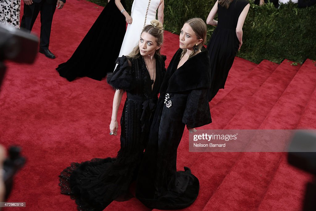 Mary Kate Olsen and Ashley Olsen attend the 'China: Through The Looking Glass' Costume Institute Benefit Gala at the Metropolitan Museum of Art on May 4, 2015 in New York City.