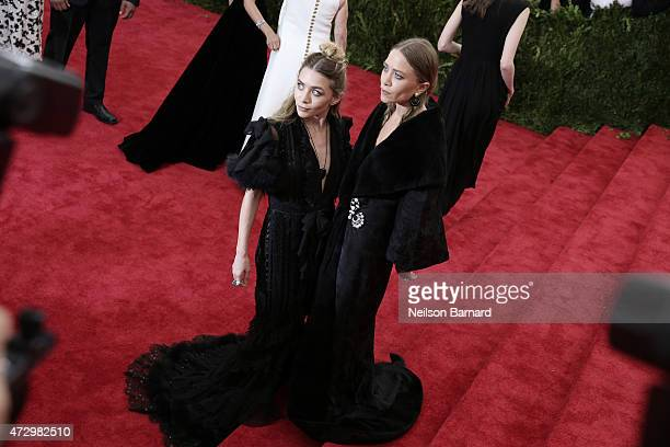 Mary Kate Olsen and Ashley Olsen attend the 'China Through The Looking Glass' Costume Institute Benefit Gala at the Metropolitan Museum of Art on May...