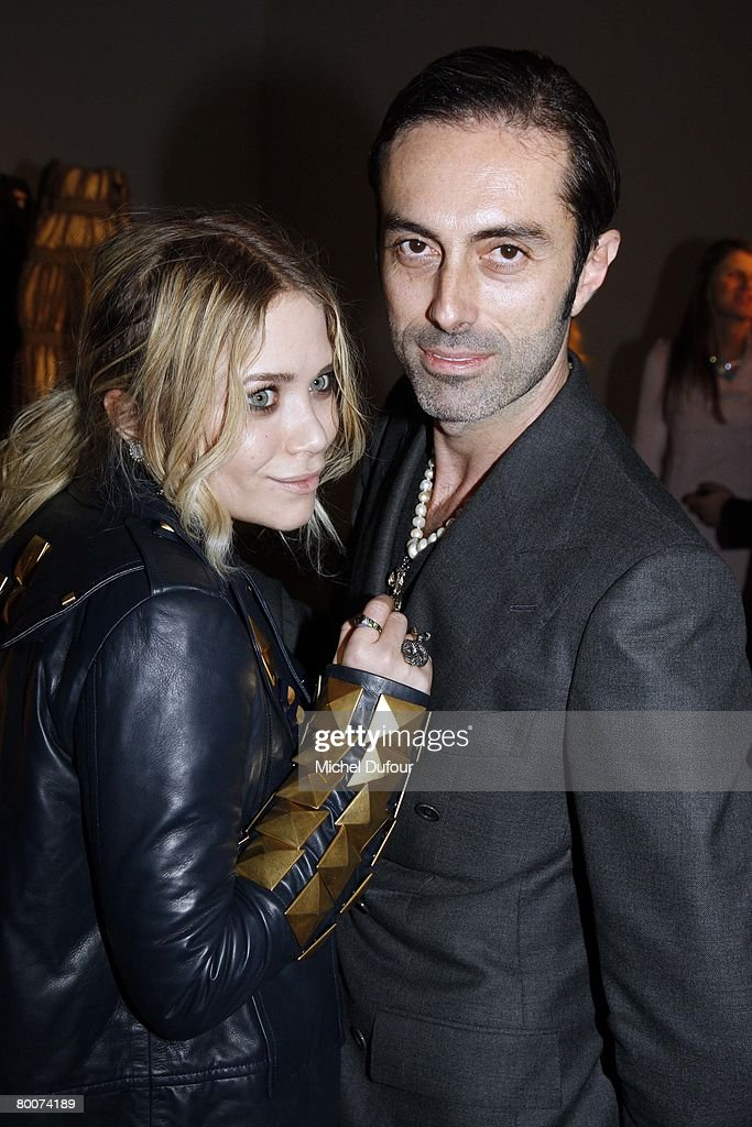Mary Kate Olsen and Giambattista Valli attends the Moncler Fashion show gamme Rouge designed by Giambattita Valli during Paris Fashion Week...