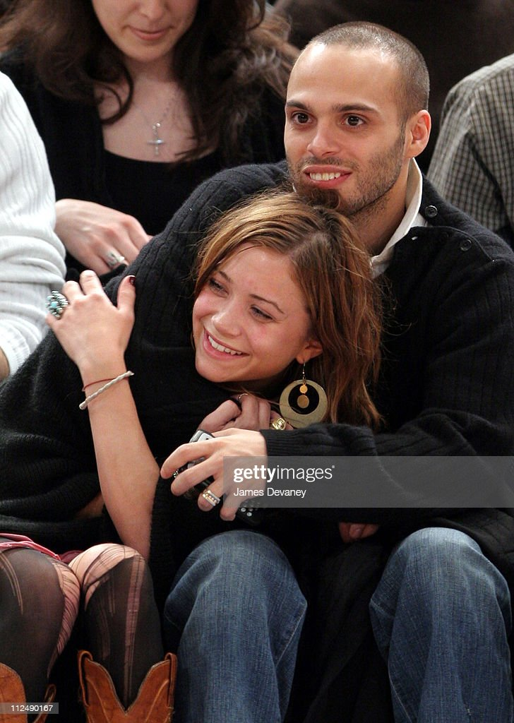 Mary Kate Olsen and Richie Akiva during Celebrities Attend Boston Celtics vs New York Knicks Game March 23 2005 at Madison Square Garden in New York...