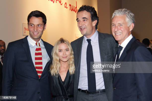 Mary Kate Olsen Oliver Sarkozy and David Kratz attend the 2013 'Take Home A Nude' Benefit Art Auction And Party at Sotheby's on October 8 2013 in New...