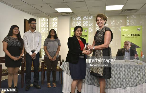 Mary Kay Carlson Charge d' Affair giving away the Student Visa to Indian students on the 'Student Visa Day' at American Embassy on June 8 2017 in New...