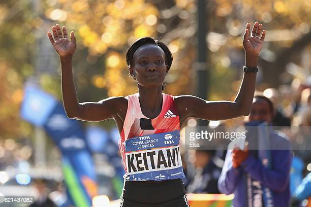 Mary Keitany of Kenya crosses the finish line to finish first in the Professional Women's Division during the 2016 TCS New York City Marathon in...