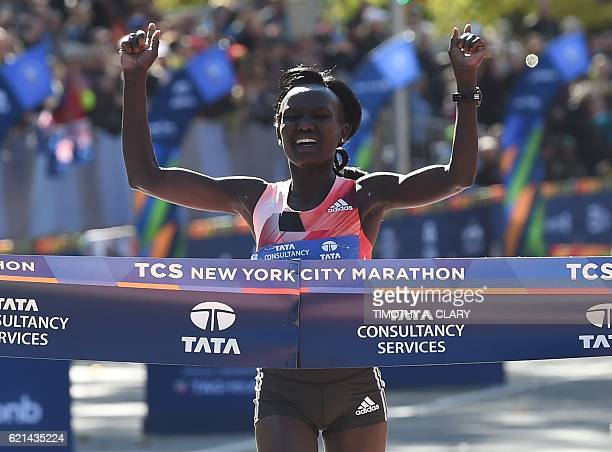 Mary Keitany of Kenya crosses the finish line to win the Women's Division during the 2016 TCS New York City Marathon November 6 2016 in New York /...
