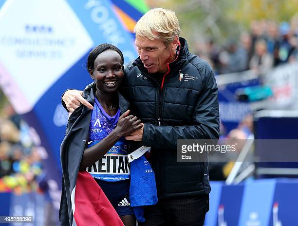 Mary Keitany of Kenya is congratulated by Peter Ciaccia Presidend of Events for the New York Road Runners and Race Director of TCS New York City...