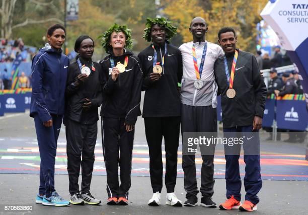 Mary Keitany of Kenya Mamitu Dasku of Ethiopia Shalane Flanagan of the United States Geoffrey Kamworor of Kenya Wilson Kipsang of Kenya and Lelisa...