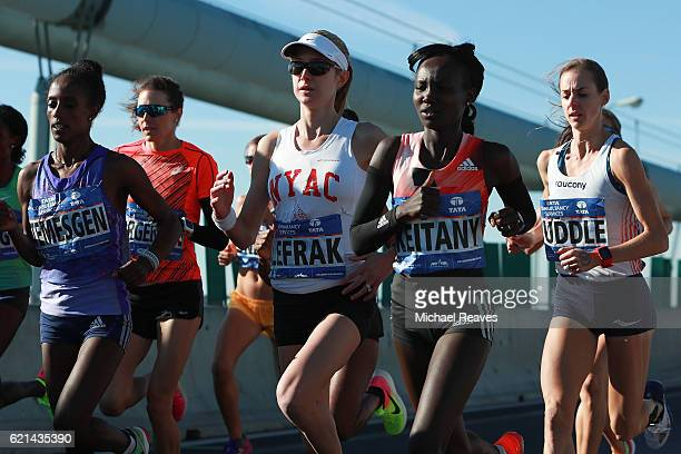 Mary Keitany of Kenya Molly Huddle of the United States and competitors in the Professional Women's division cross the VerrazanoNarrows Bridge at the...