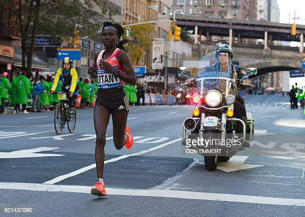 Mary Keitany of Kenya runs in the TCS New York City Marathon November 6 2016 in New York City Keitany ran to her third consecutive victory on Sunday...