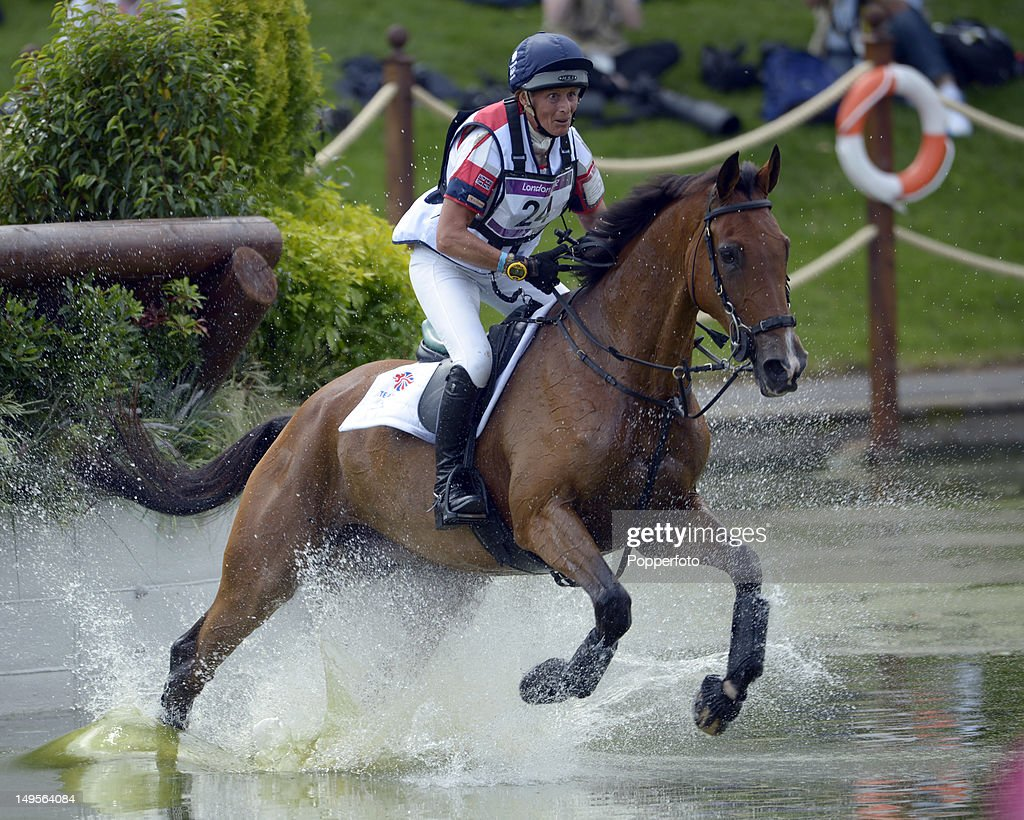 Mary King of Great Britain riding Imperial Cavalier negotiates the water jump in the Eventing Cross Country Equestrian event on Day 3 of the London...