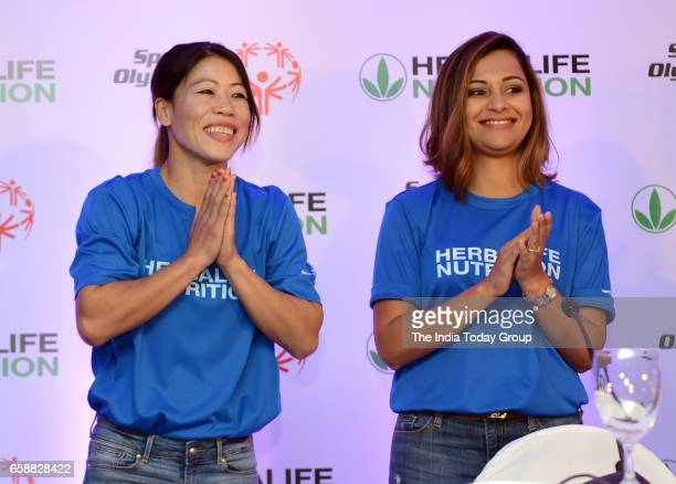 Mary Kom and Heena Sidhu at a Felicitation function of BWF World Superseries 2017 in New Delhi