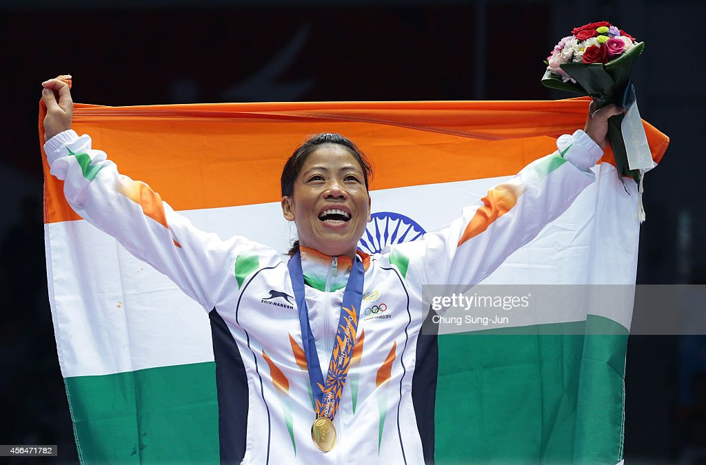 C Mary Kom of India celebrates after winning the Womens Flyweight Final on day twelve of the 2014 Asian Games at Seonhak Gymnasium on October 1 2014...