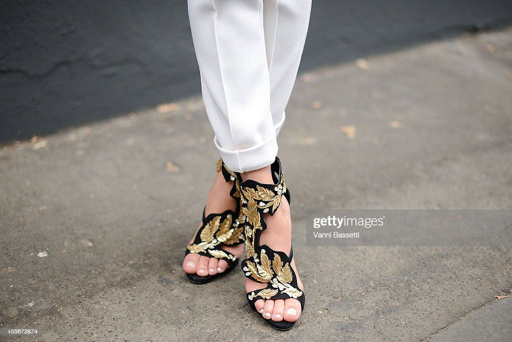 Mary Leest poses wearing a Ksenia Avakyan dress and Giuseppe Zanotti shoes on September 18 2014 in Milan Italy