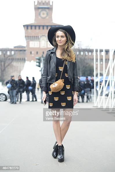 Mary Leest poses wearing a Moschino dress and bag on February 28 2015 in Milan Italy
