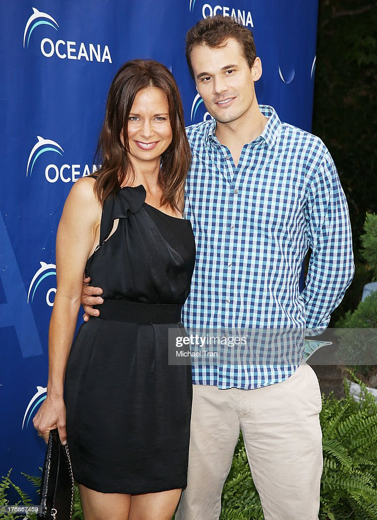 Mary Lynn Rajskub (L) and Matthew Rolph arrive at the 6th Annual Oceana's Annual SeaChange Summer Party held at a private residence on August 18, 2013 in Laguna Beach, California.