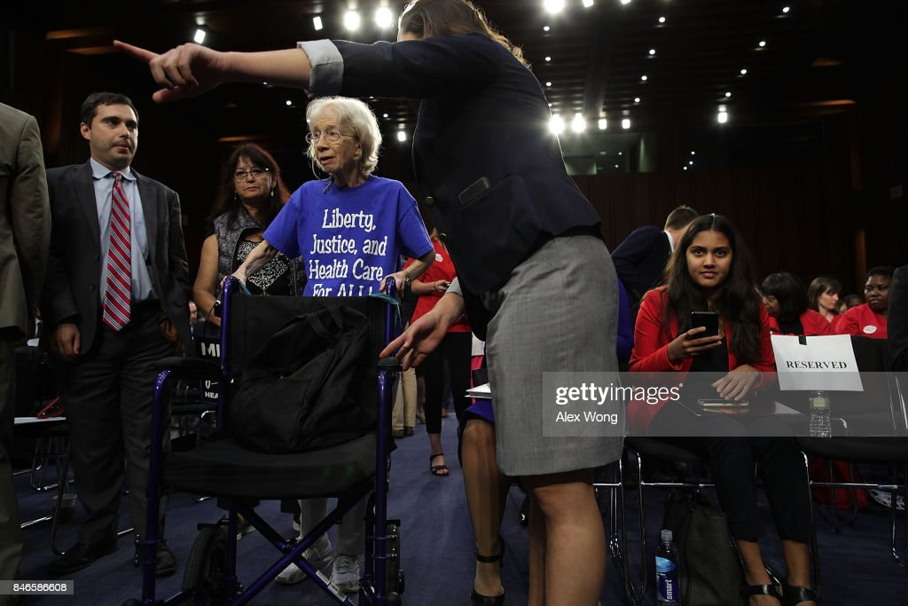 Mary MacDowell (3rd L) of Alexandria, Virginia, arrives at an event on health care September 13, 2017 on Capitol Hill in Washington, DC. Sen. Bernie Sanders (I-VT) held an event to introduce the Medicare for All Act of 2017.