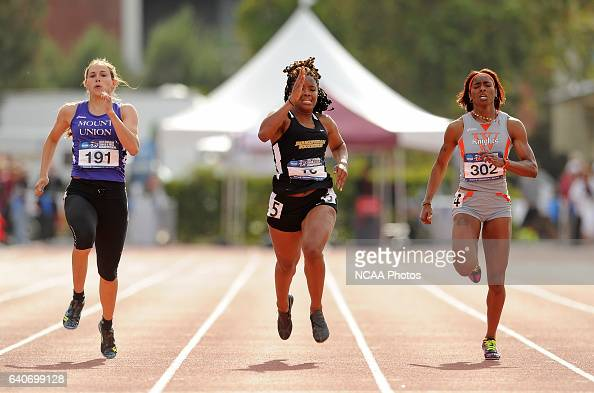 Mary Mahoney of Mount Union races to the first place against Tiarra Goode of Birmingham Southern who finished third and Nevada Morrison of Wartburg...
