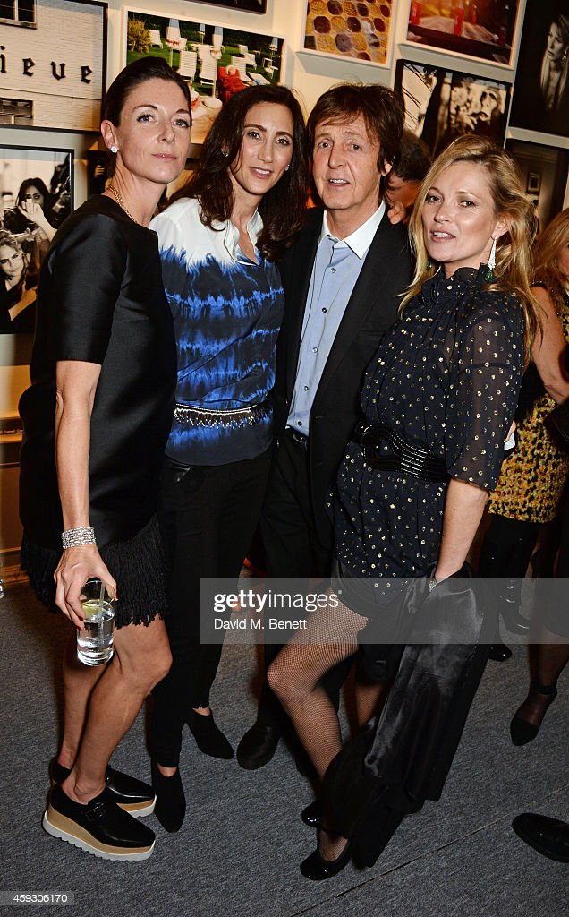 Mary McCartney, Nancy Shevell, Sir Paul McCartney and Kate Moss attend the book launch and private view of 'Mary McCartney: Monochrome And Colour' curated by De Pury De Pury on November 20, 2014 in London, England.