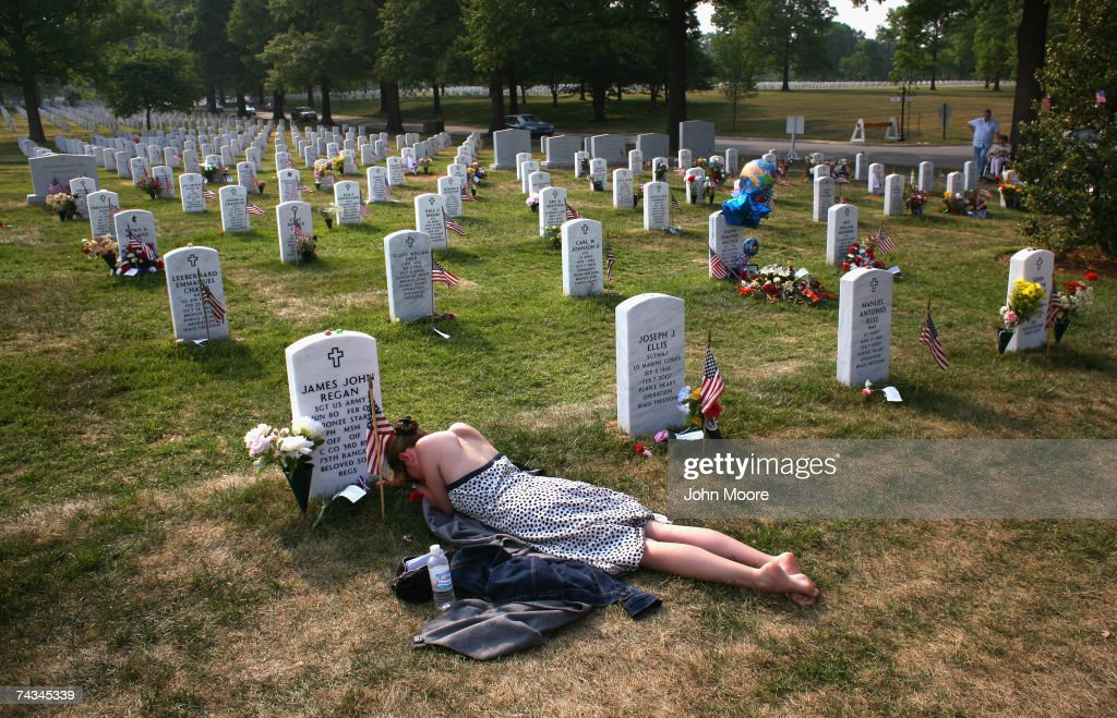 Mary McHugh mourns her slain fiance Sgt. James Regan at 'Section 60' of the Arlington National Cemetery May 27, 2007. Regan, a US Army Ranger, was killed by an IED explosion in Iraq in February of this year, and this was the first time McHugh had visited the grave since the funeral. Section 60, the newest portion of the vast national cemetery on the outskirts of Washington D.C, contains hundreds of U.S. soldiers killed in Iraq and Afghanistan. Family members of slain American soldiers have flown in from across the country for Memorial Day.