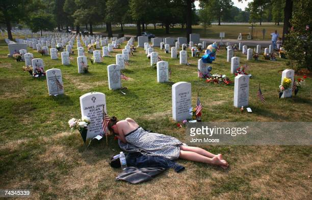 Mary McHugh mourns her slain fiance Sgt James Regan at 'Section 60' of the Arlington National Cemetery May 27 2007 Regan a US Army Ranger was killed...