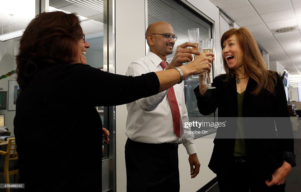 Mary McNamara left Davan Maharaj middle editor of the Los Angeles Times and Diana Marcum right react to the announcement that Mary and Diana both won...