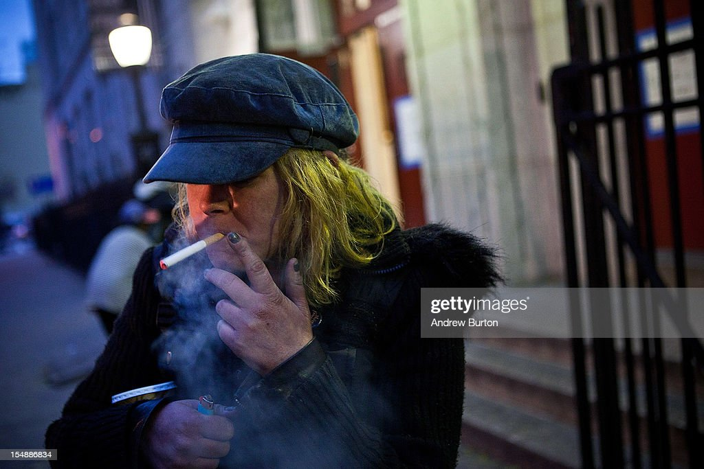 Mary McSweeney, who is staying at the evacuation center stationed inside Seward Park High School, has a cigarette prior to the arrival of Hurricane Sandy, on October 28, 2012 in New York City. Sandy, which has already claimed over 50 lives in the Caribbean, is predicted to bring heavy winds and floodwaters as the mid-atlantic region prepares for the damage.