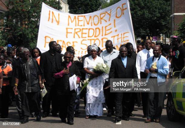 Mary Moody walks with friends and relatives at a vigil in Lambeth London for her son Freddy Moody Boateng who was stabbed to death after a row over a...