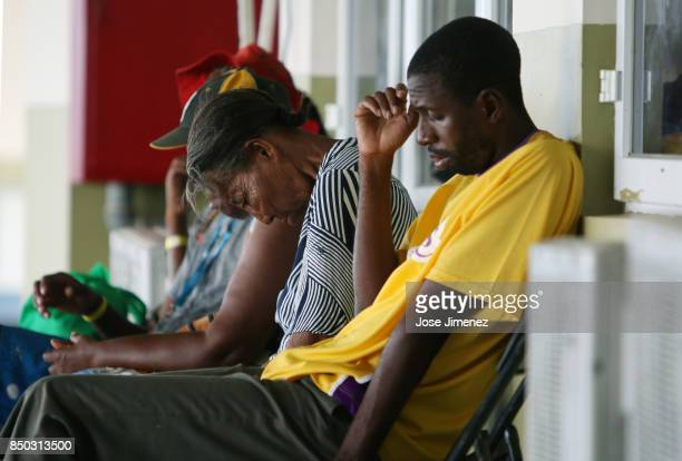 Mary Naryfrank and her son Lathalie Johl sit at a shelter in the Sir Vivian Richards Cricket Stadium on September 20 2017 in North Sound Antigua and...