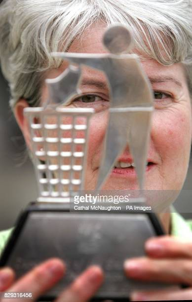 Mary O'Brien secretary of the Lismore Tidy Town comittee at Dublin Castle with the winners trophy after the County Waterford town was crowned the...