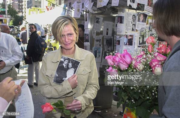 Mary Ortale left of Brooklyn NY holds a picture of herself with her missing husband Peter at the 69th Regiment Armory in New York Saturday Sept 15...
