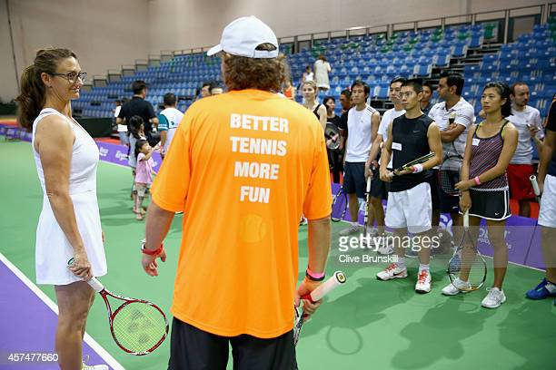 Mary Pierce of France during a coaching clinic prior to the start of the BNP Paribas WTA Finals at Singapore Sports Hub on October 19 2014 in...