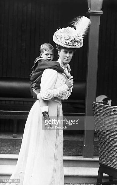 Mary Princess of Wales gives a piggyback ride to her son Prince George the future Duke Of Kent