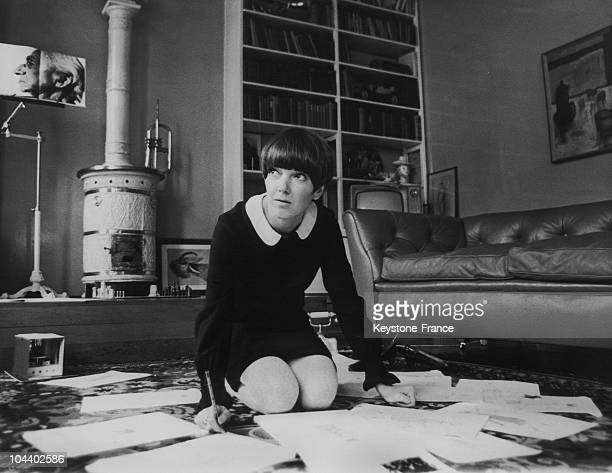Mary QUANT fashion designer and initiator of the miniskirt is seen in her flat in Dracott Place Chelsea surrounded by fashion drawings as she plans...