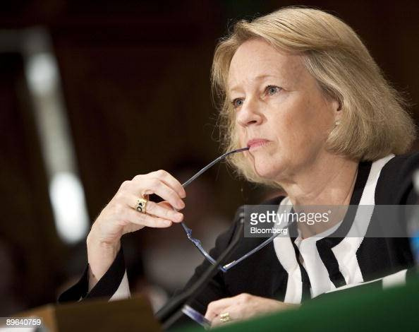 Mary Schapiro chairman of the US Securities and Exchange Commission listens during a Senate Banking subcommittee hearing in Washington DC US on...