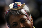 Mary Seymore wears a tiny hat that reads 'No Friggin' Big Hats' during day one of the Democratic National Convention at Time Warner Cable Arena on...